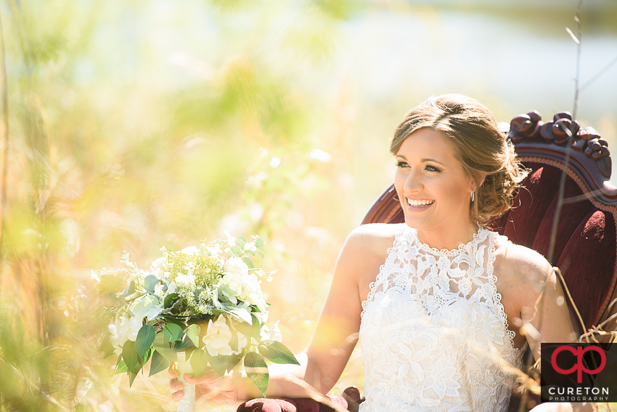 Bride sitting in a vintage chair during a Furman University bridal session.