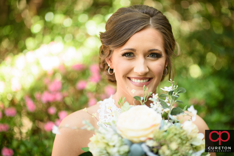 Whimsical bridal photo with vintage flowers .