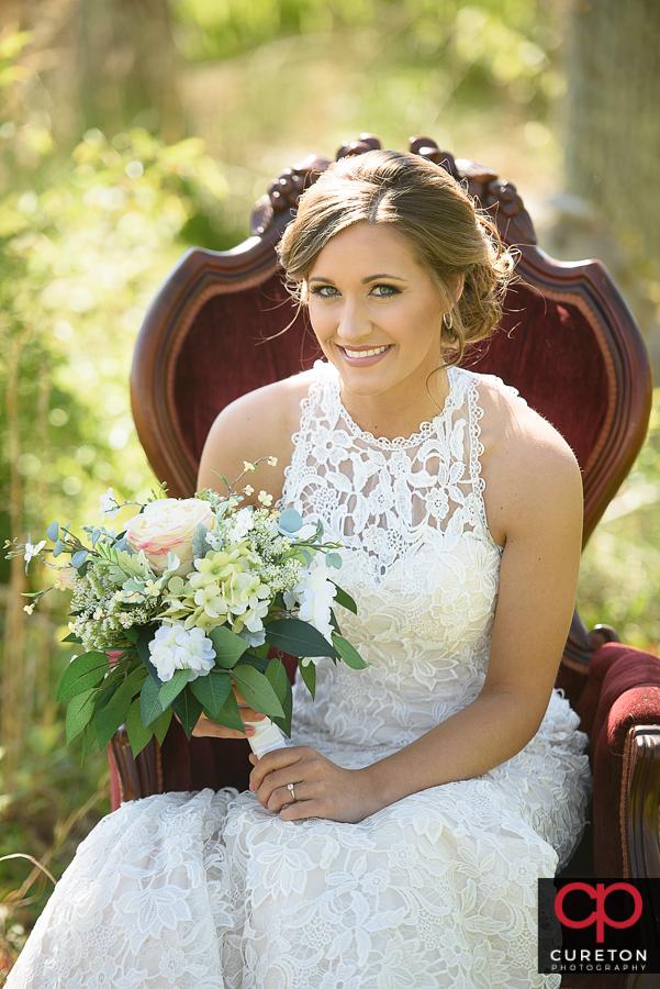 Bride ina vintage chair.