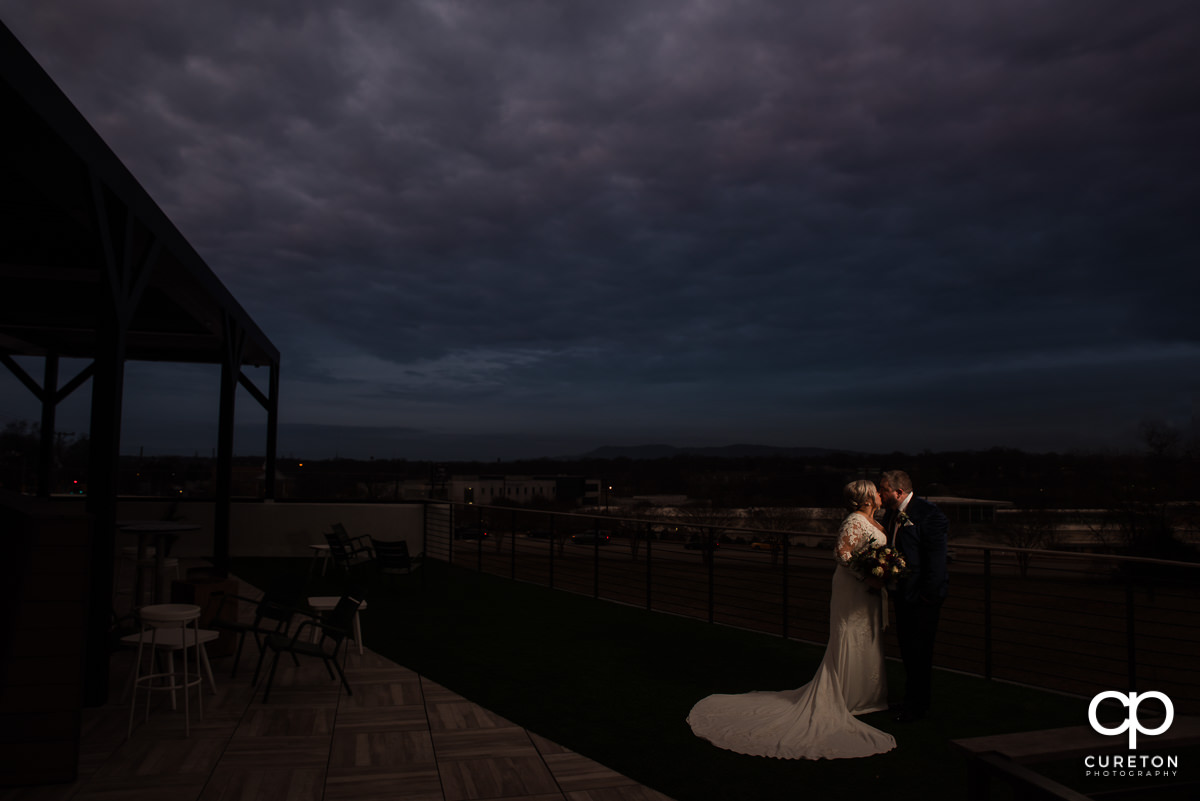 Bride and groom on a rooftop in Greenville.