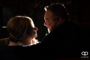 Newlyweds backlit by a strobe.