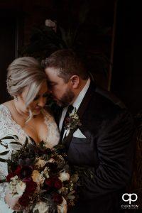 Groom hugging his bride.
