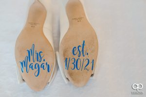 Bride's shoes with date stickers on them.