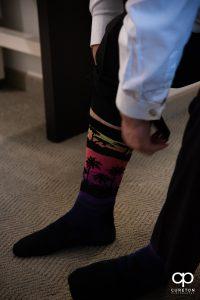 Groom putting on retro socks.