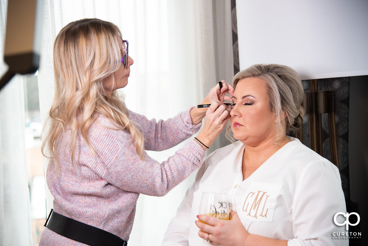 Bride having her makeup applied.