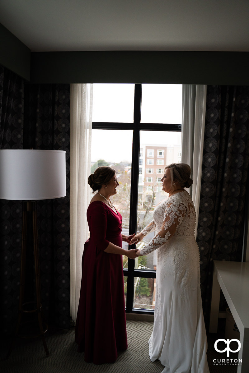 Bride having a moment with her mom before the wedding.