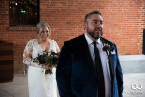 Bride sneaking up on her groom.