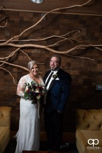 Bride and groom in the lobby of Urban Wren.