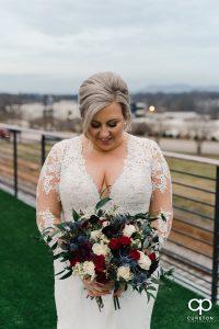 Bride looking at her flowers.