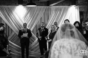 Groom watching the bride walk down the aisle.