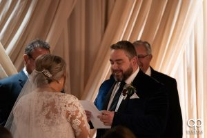 Groom reading his vows.