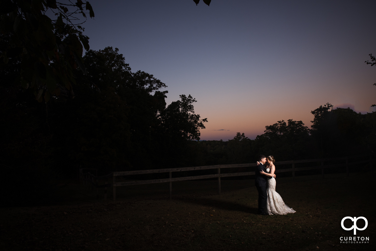 Bride and groom dancing at sunset at their Viewpoint at Buckhorn Creek wedding in Greenville,SC.