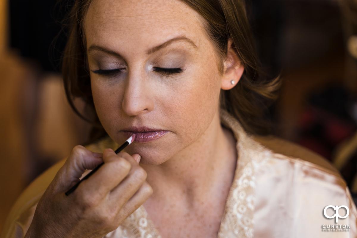 Bride having her makeup applied.