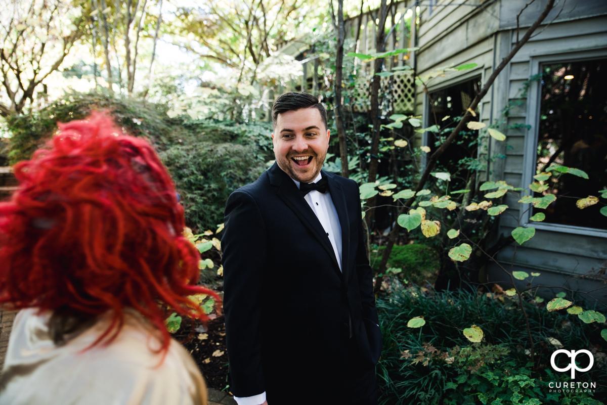 Groom surprised as he sees his bride wearing a clown mask.