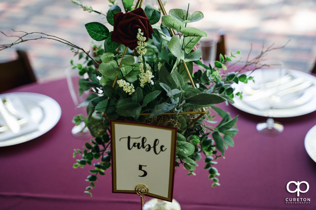 Wedding florals on a table at the reception.