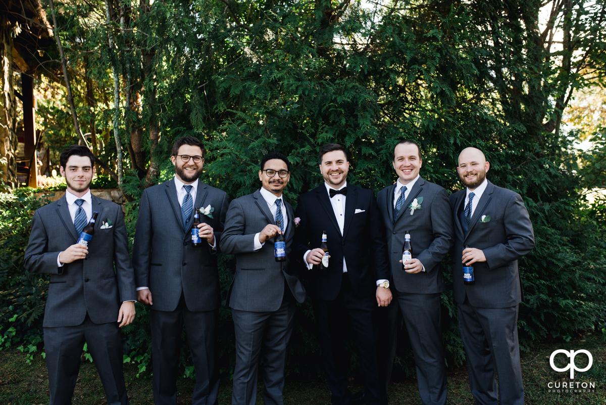 Groom and the groomsmen drinking beers.