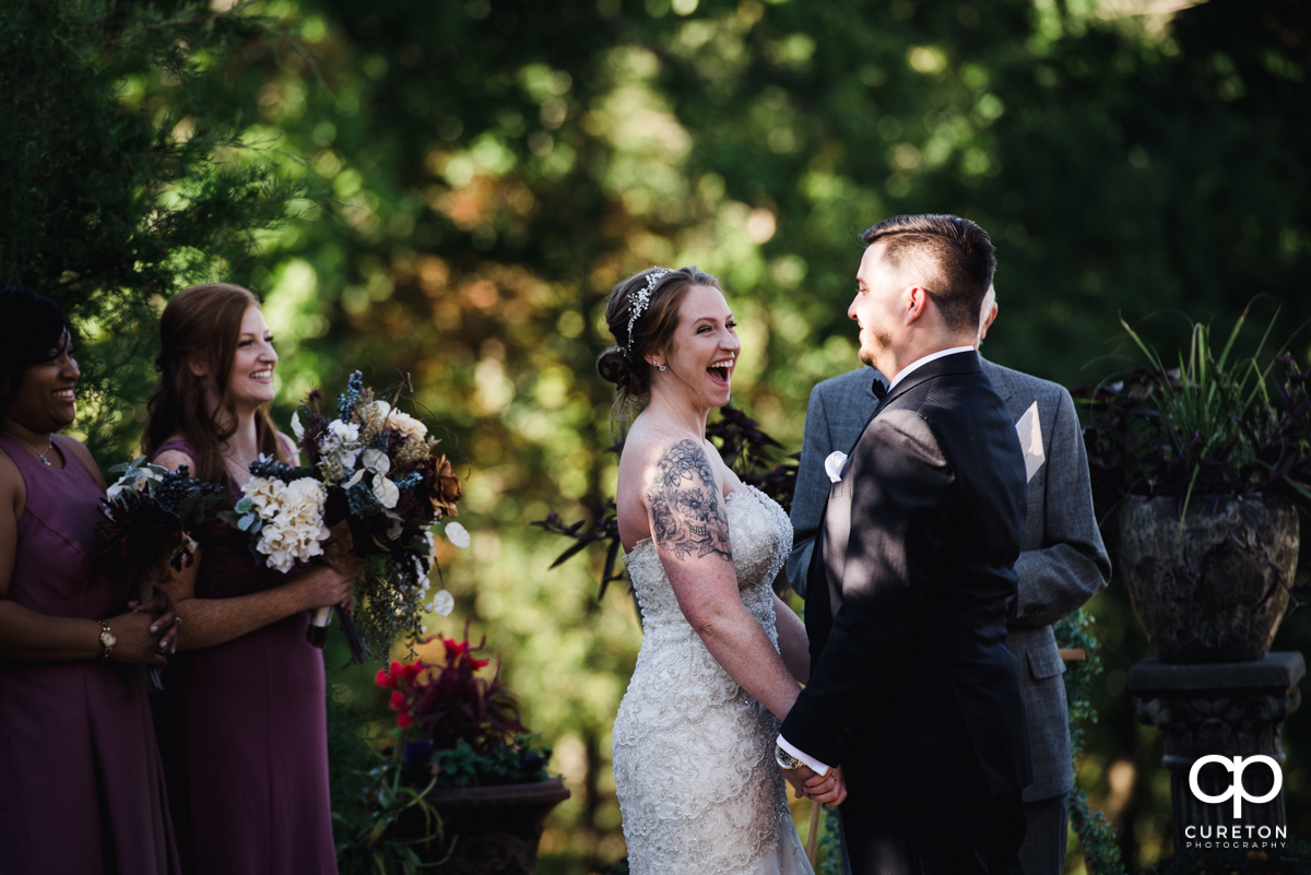 Bride smiling during the wedding ceremony at the Viewpoint at Buckhorn Creek.