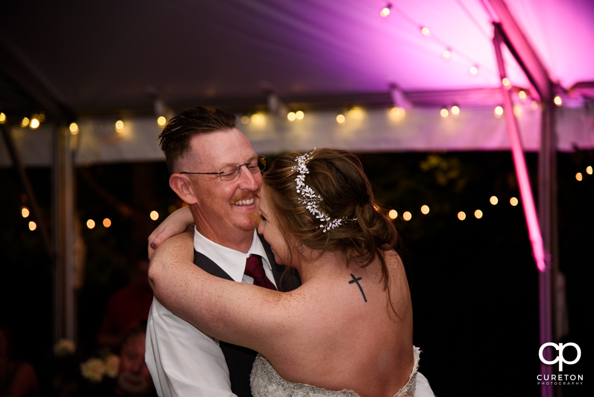 Bride's father sharing a dance with her at the reception.