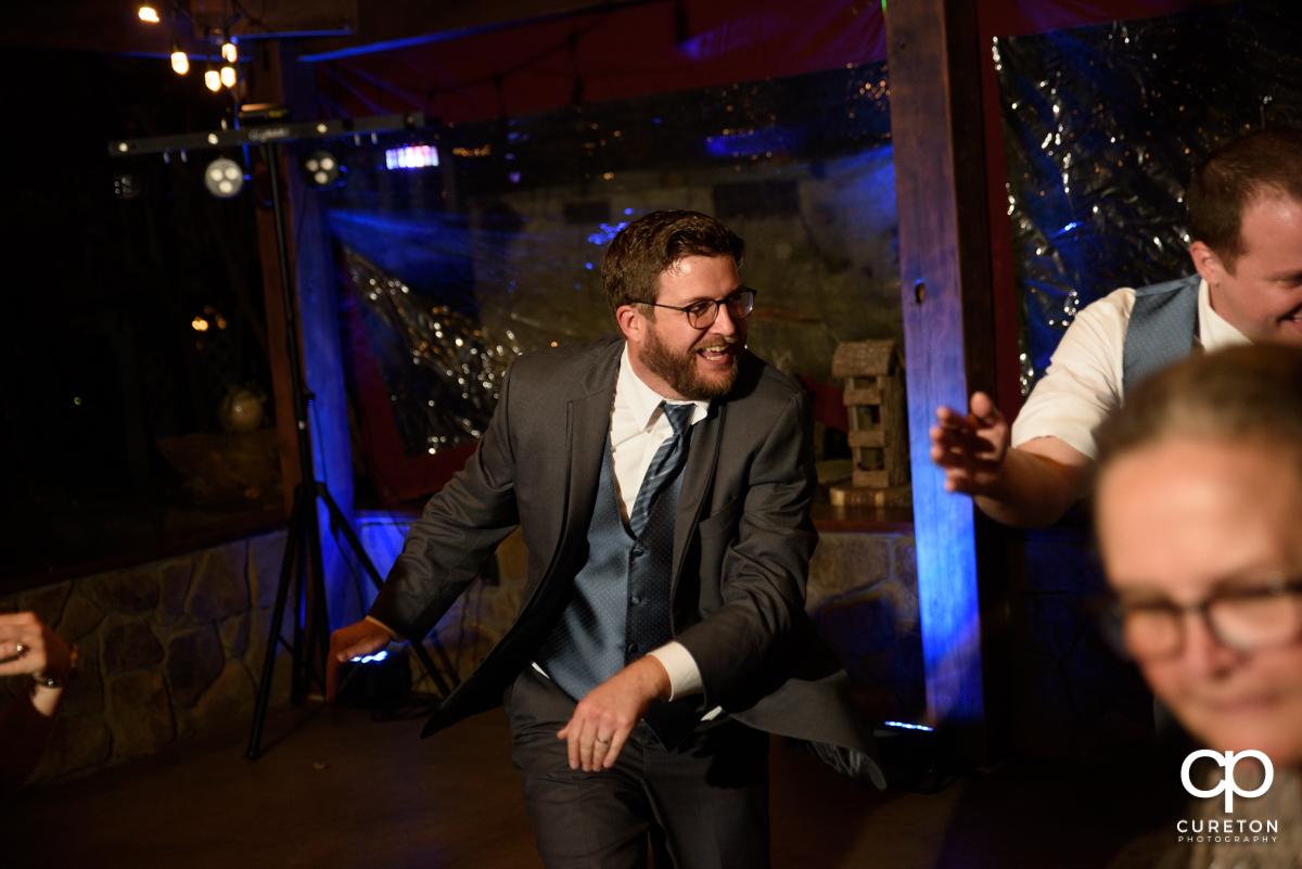 Wedding reception guests dancing.