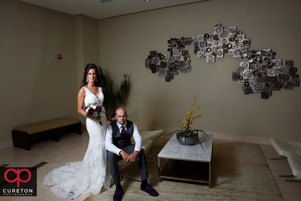 Bride and groom posing before their wedding at the commerce club in Greenville South Carolina.