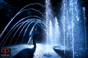 Bride and groom dancing in the fountain after their wedding at the commerce club in Greenville South Carolina.