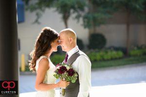 Bride and groom in front of the Hyatt Regency in downtown Greenville.