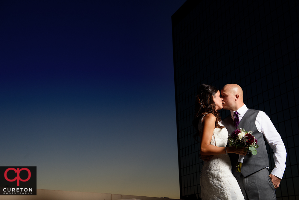 Bride and groom during sunset at their commerce club wedding.