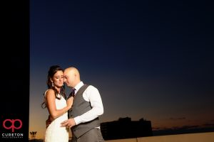 Bride and groom on the rooftop during their commerce club wedding at sunset.