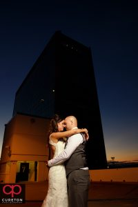 Bride and groom at sunset during their commerce club wedding reception in Greenville South Carolina.
