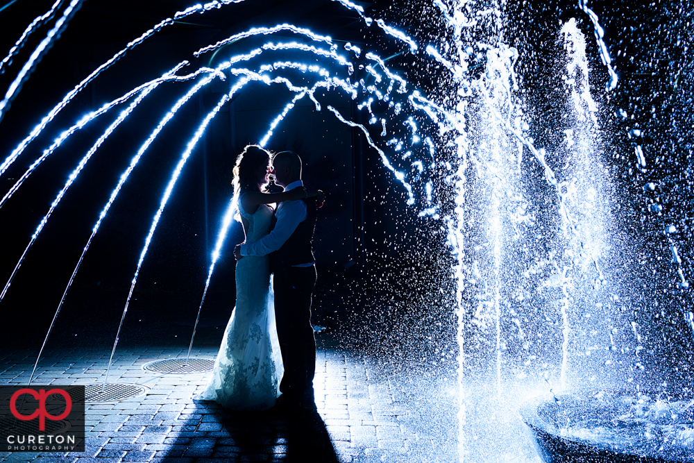 Married couple in the fountain after their wedding at the commerce club.