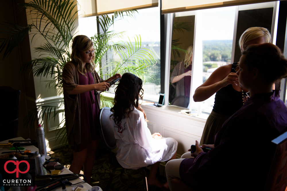 Bride getting her hair done.