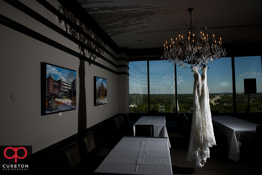 Wedding dress hanging in the commerce club.