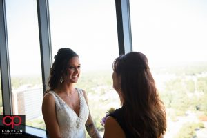 Bride and her mother are sharing a minute before her wedding.