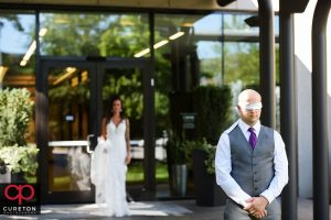 Groom blindfolded for the first look.