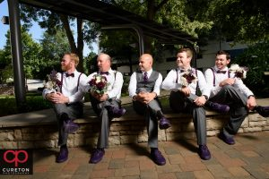 Groomsmen with flowers outside the commerce club.