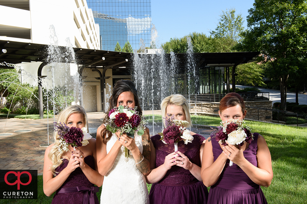 Bridesmaids and their flowers.