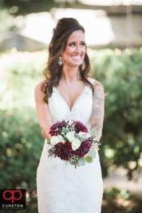 Beautiful bride showing off her bouquet.