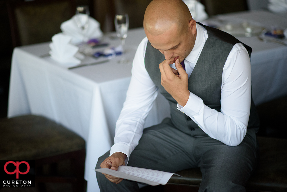 Groom reading a letter from his bride.