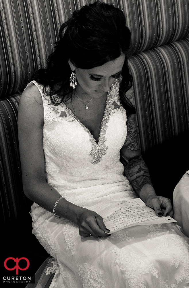 Bride reading a letter from the groom.