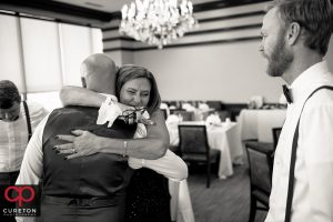Grooms mother crying hugging her son before the wedding.
