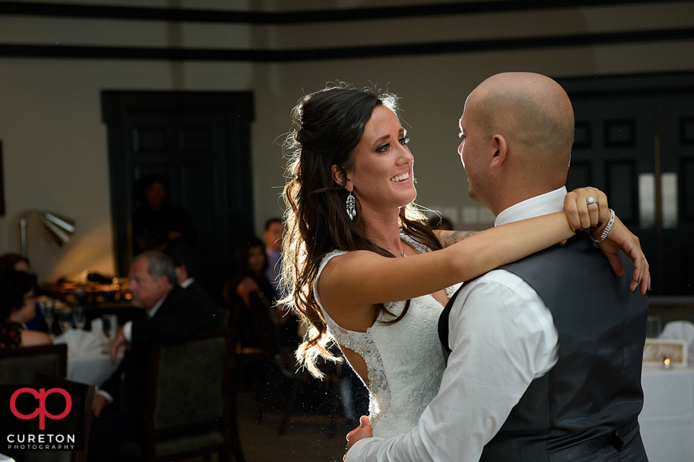 Bride smiling at her groom during their first dance.