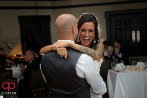 Bride laughing during their first dance.