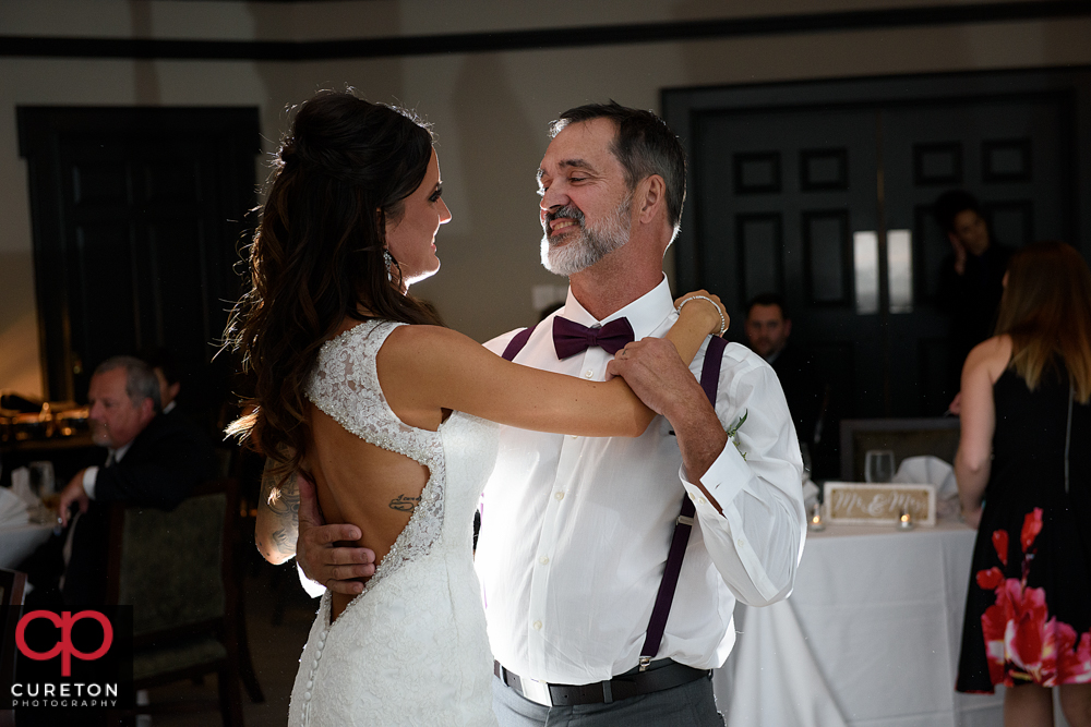 Father and daughter dance at the reception.