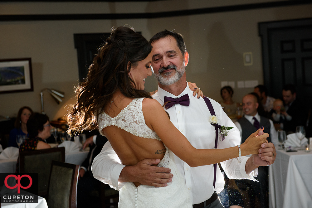 Father and daughter dance during the reception.