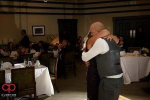 Groom hugging his mother.