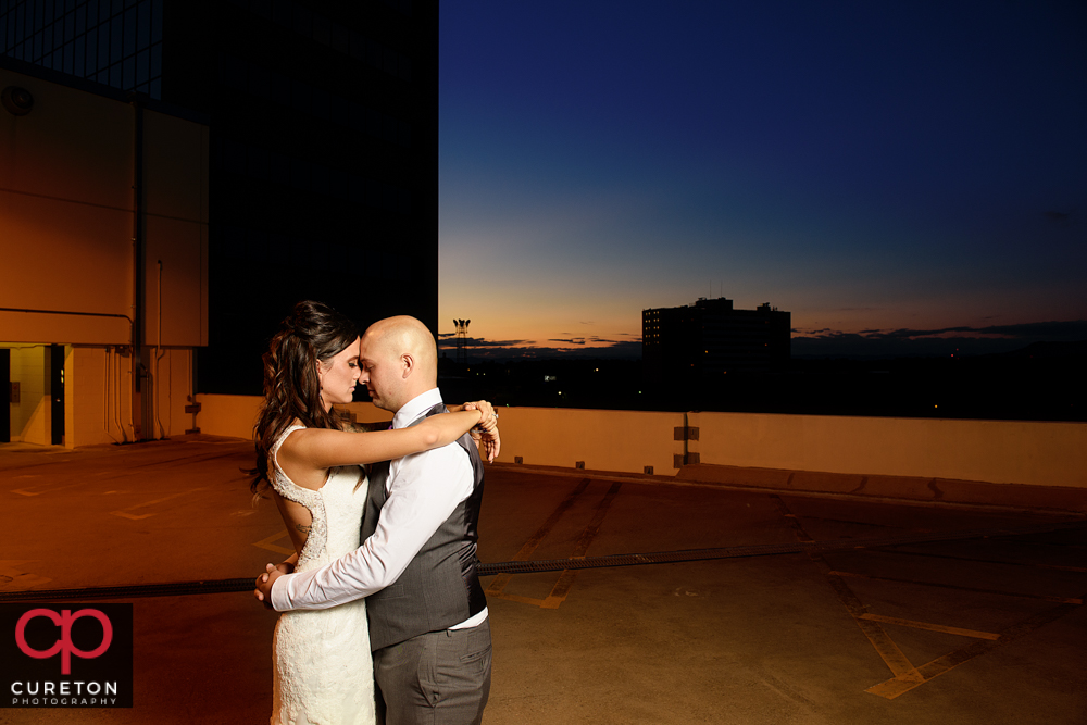 Bride and groom at sunset at the commerce club.