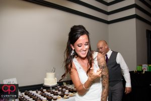 Bride getting cake on her face.