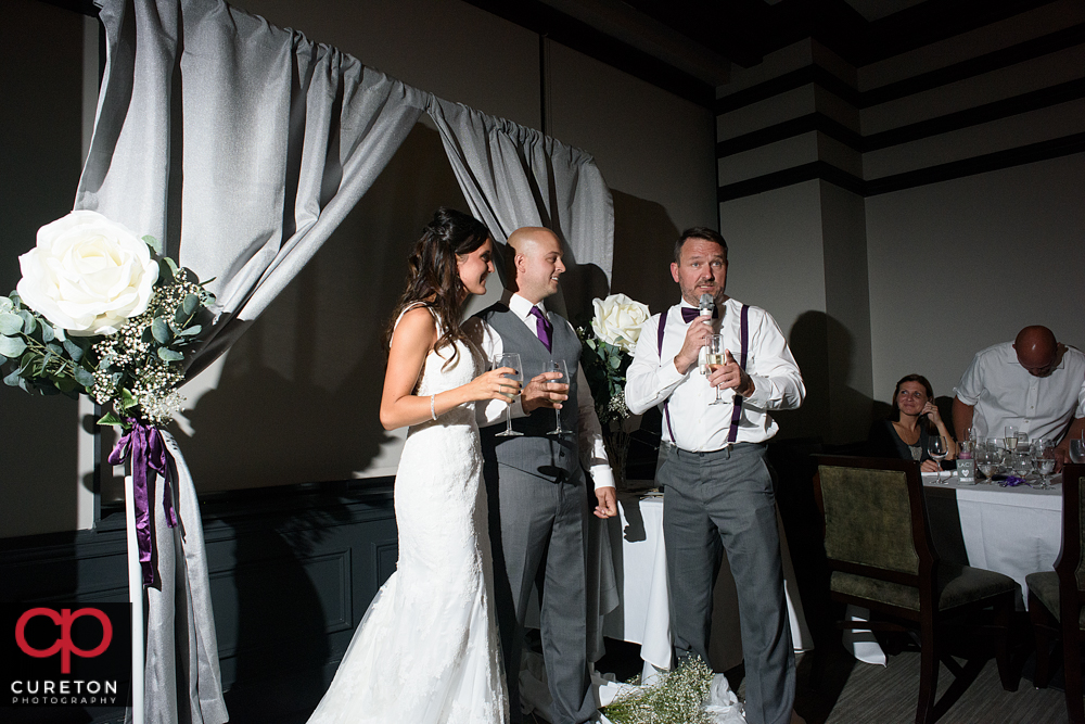 Best man giving a toast.