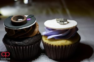 Wedding rings sitting on top of cupcakes from buttercream bakehouse.