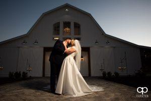 Bride and groom kissing outside of Heyward Manor in Iva,SC.